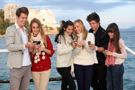 kids texting with mobile or cell phones Stock Photo