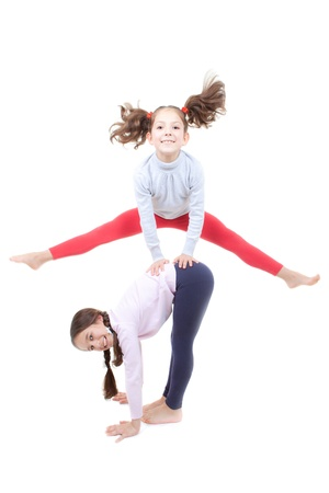 active children playing leapfrog and jumping photo
