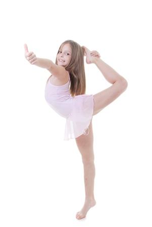 turnanzug: Kind Ballett-Tänzerin mit Balance und Körperhaltung