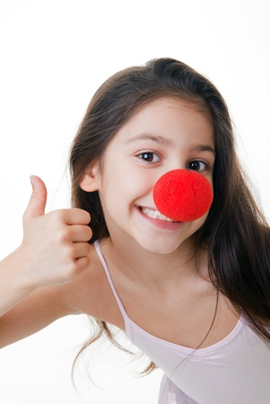 child with red clown nose thumbs up Stockfoto