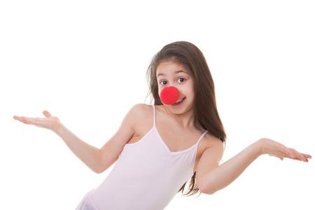 tonto: niño feliz o niño con nariz roja de payaso Foto de archivo