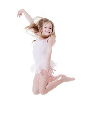 happy  child ballerina dancing ballet and jumping photo