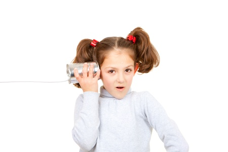 communication concept child listening with tin can and string phone photo