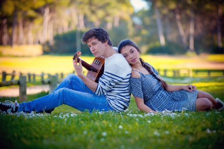 romantic couple in love playing guitar photo