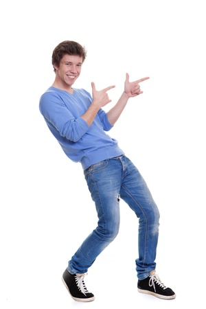 teen boy face: happy teen pointing at copy space