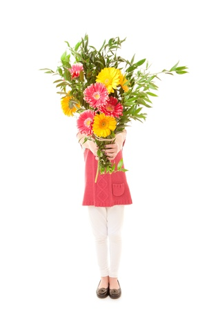 child with bunch of  flowers as mothers day gift. Foto de archivo