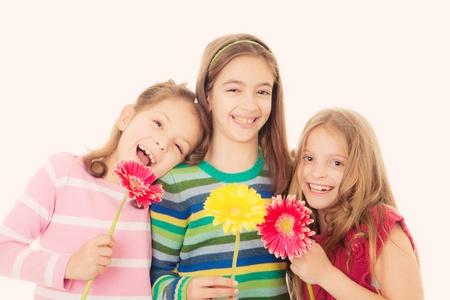 mothering: happy  kids with flower gifts for mothers day