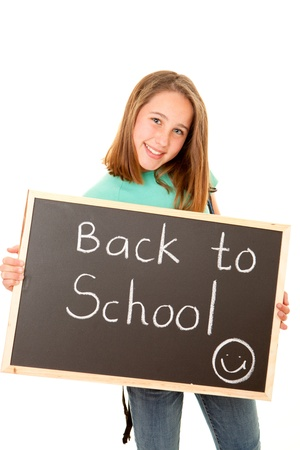 student with back to school written on blackboard photo