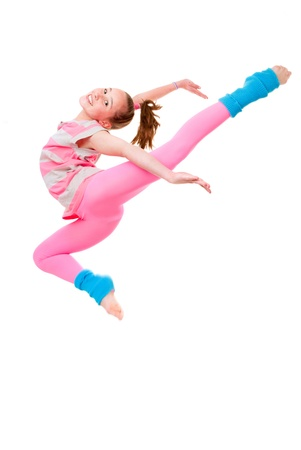 female gymnast: happy child or girl doing ballet jump Stock Photo