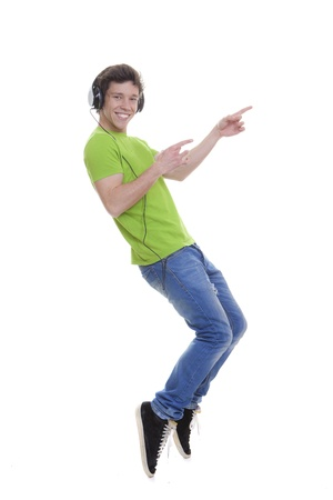 tiptoes: pointing teen with headphones Stock Photo