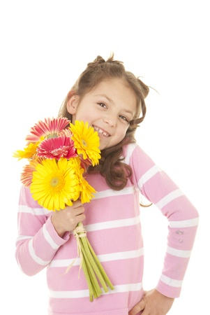 mothering:  happy smiling child with bunch of flowers
