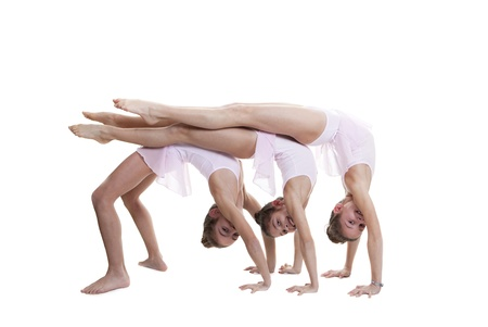 gym class: young girls kids or children doing gymnastic in gym class