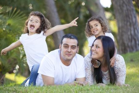 happy smiling hispanic family parents and children