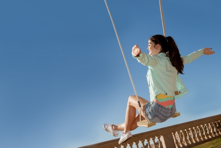 teen freedom, girl on swing in summer