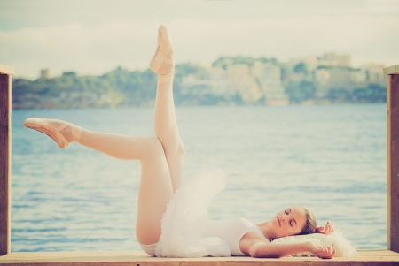 relaxation, woman ballet dancer relaxing in peace