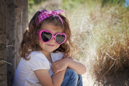 Summer kid child or little girl wearing sunglasses photo