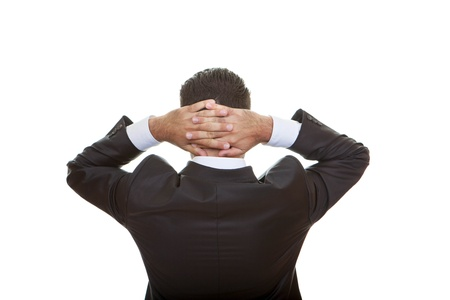 man behind: business man back view thinking hands clenched behind head Stock Photo