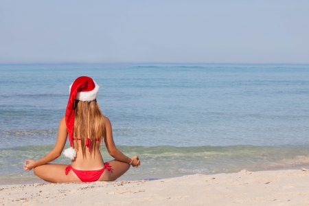 relaxing woman at beach christmas vacation photo