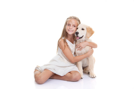 kids hugging: child with pet puppy dog