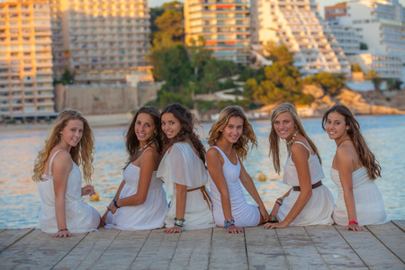 beautiful teens in white clothes on summer vacation
