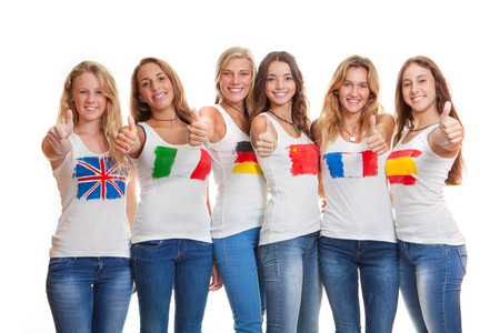 international teens with flags on t shirts photo
