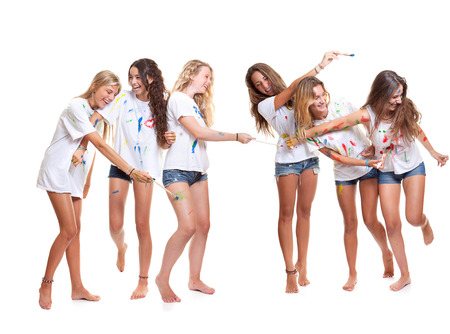group of kids at summer camp having fun with paint photo