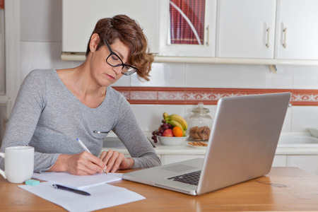 blogs: woman working or blogging in home office.