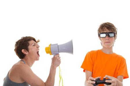Mère en colère de teen jouer à des jeux informatiques Banque d'images - 26407298