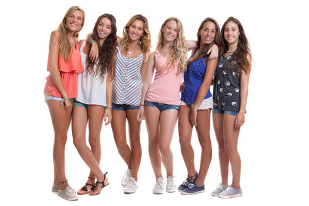 wearing sandals: group of healthy tanned smiling summer teenage girls
