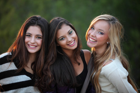 smiling teens with beautiful white teeth