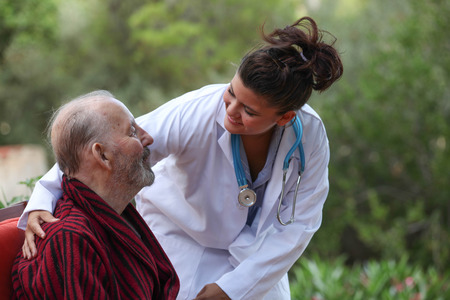 caring for: smiling Doctor caring for patient Stock Photo