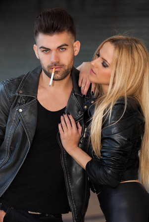 rockstar: fashion couple smoking cigarette Stock Photo