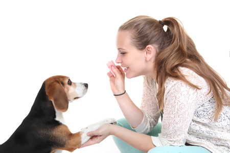 smiing: dog obedience trainingm trainer with pet.