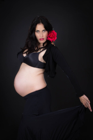 keeping fit: pregnant spanish dancer  keeping fit.