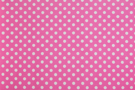 spotty: while dots on pink background Stock Photo