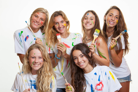 group of teenagers having fun with paint photo