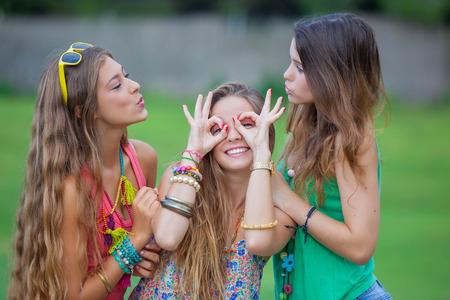 goofing: playful teen girls goofing