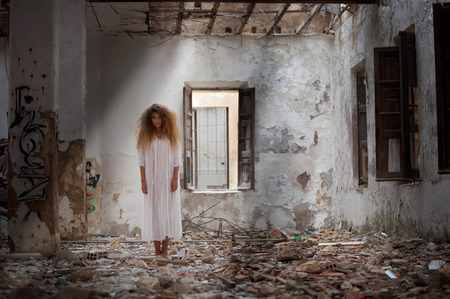 abandoned house: ghost woman in abandoned house Stock Photo