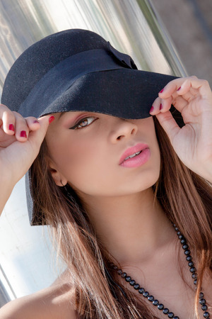 flawless: beautiful fashion woman with hat make up and flawless skin