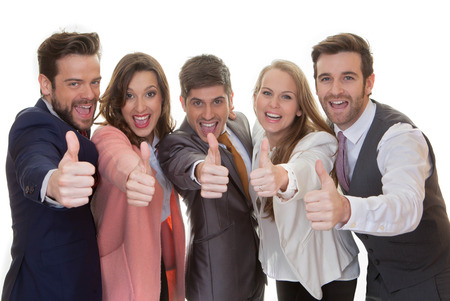 successful business team group with thumbs up