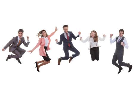 幸せなビジネス チーム グループの成功のためにジャンプ