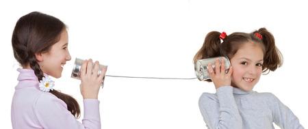 Communicatie concepten kinderen spelen met tinnen kan en string telefoon Stockfoto - 36763479