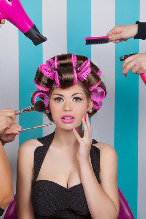 blows: retro pin up woman getting pampered  in beauty salon