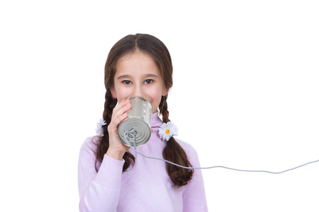 tin can phone: communication concept child with tin can and string telephone Stock Photo