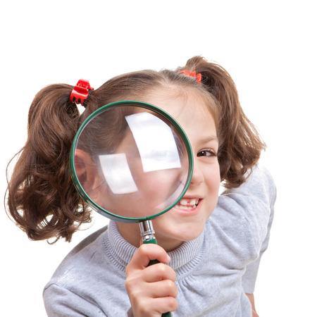 spy glass: child with magnifying spy glass