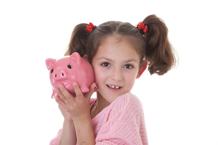 coinbank: child with savings in piggy bank money box