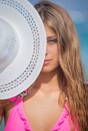 sunhat: woman on vacation or holiday with sunhat