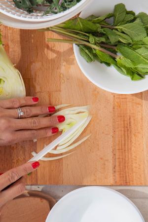 meal preparation: organic meal preparation cutting fennel bulb