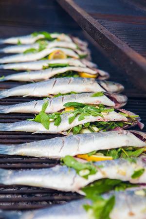 stuffed fish: stuffed sea bass  fish grilling on BBQ