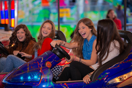 carnival bumper ride group of teens laughing